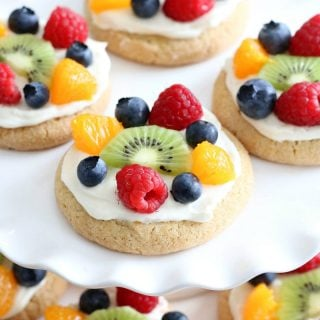 Try this semi-homemade fruit pizza on a soft sugar cookie crust and topped with a cream cheese frosting today! It's the best quick and easy Easter Dessert!