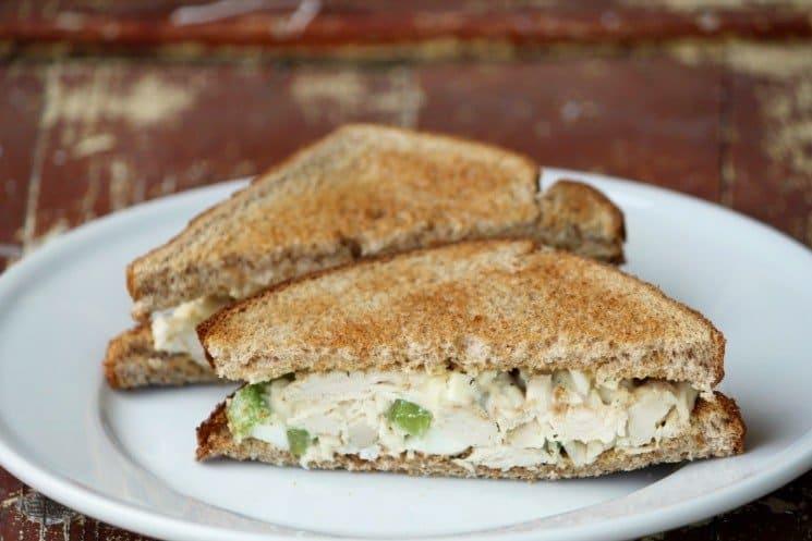 Old Fashioned Chicken Salad Sandwich cut in half on white plate