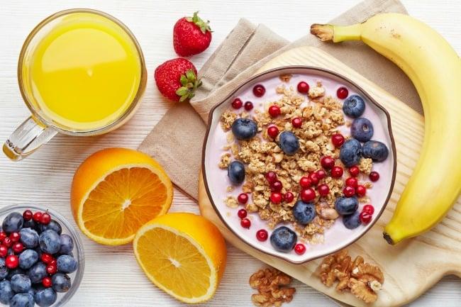 Healthy breakfast. Bowl of yogurt with granola and berries