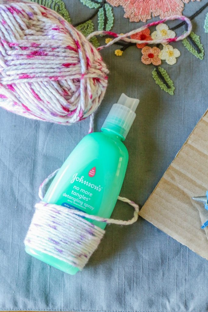 """What better way to introduce recycling and """"upcycling"""" to kids than to do some fun craft projects like this EASY DIY Recycled Bottle Flower Vase Craft?!"""
