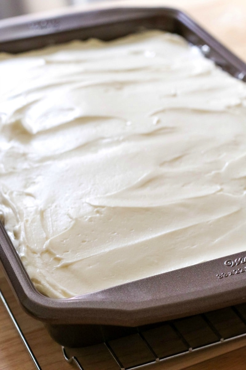 pumpkin spice cake topped with cream cheese frosting