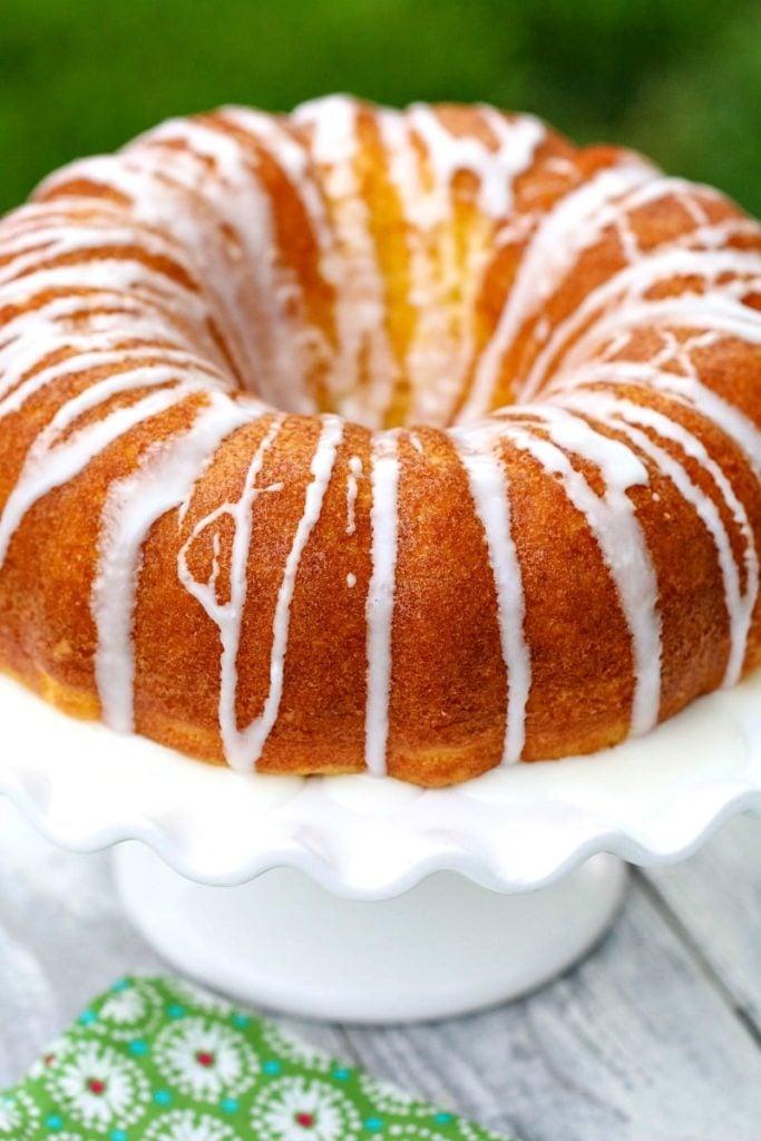 bundt cake on a white cake stand