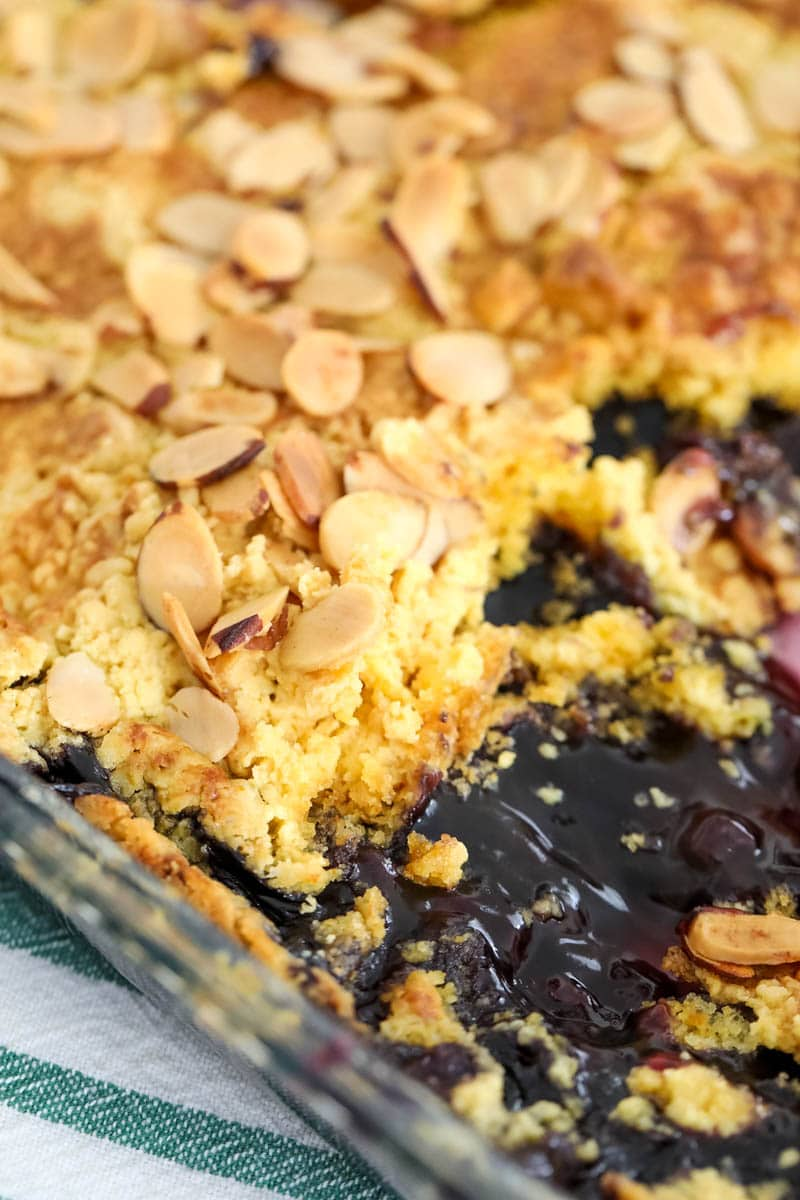 Close up of blueberry dump cake in baking dish