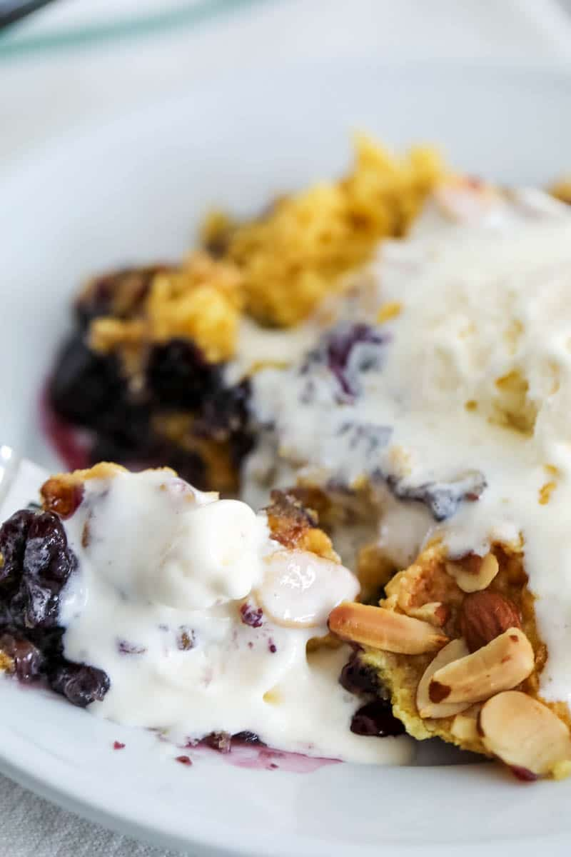 blueberry dump cake topped with ice cream