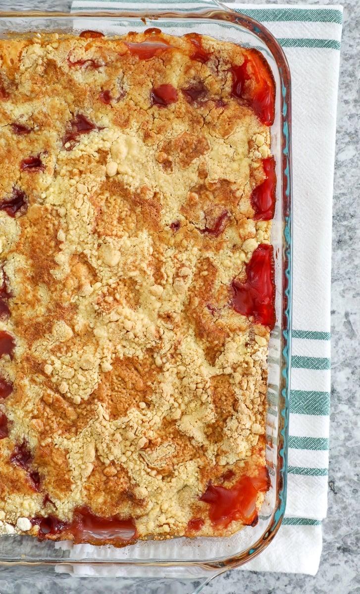cherry pineapple dump cake recipe in baking dish
