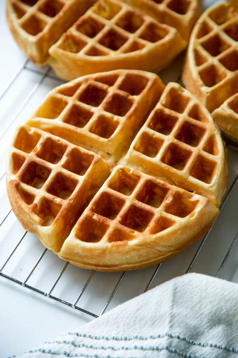 homemade waffles on a rack after cooking