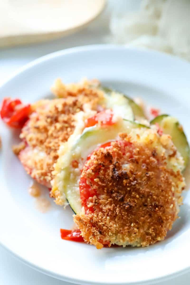 Cheesy tomato zucchini casserole on a plate