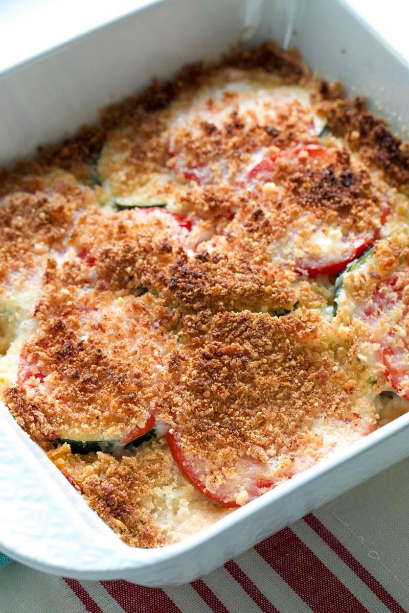Cheesy Tomato Zucchini Casserole recipe in square casserole dish