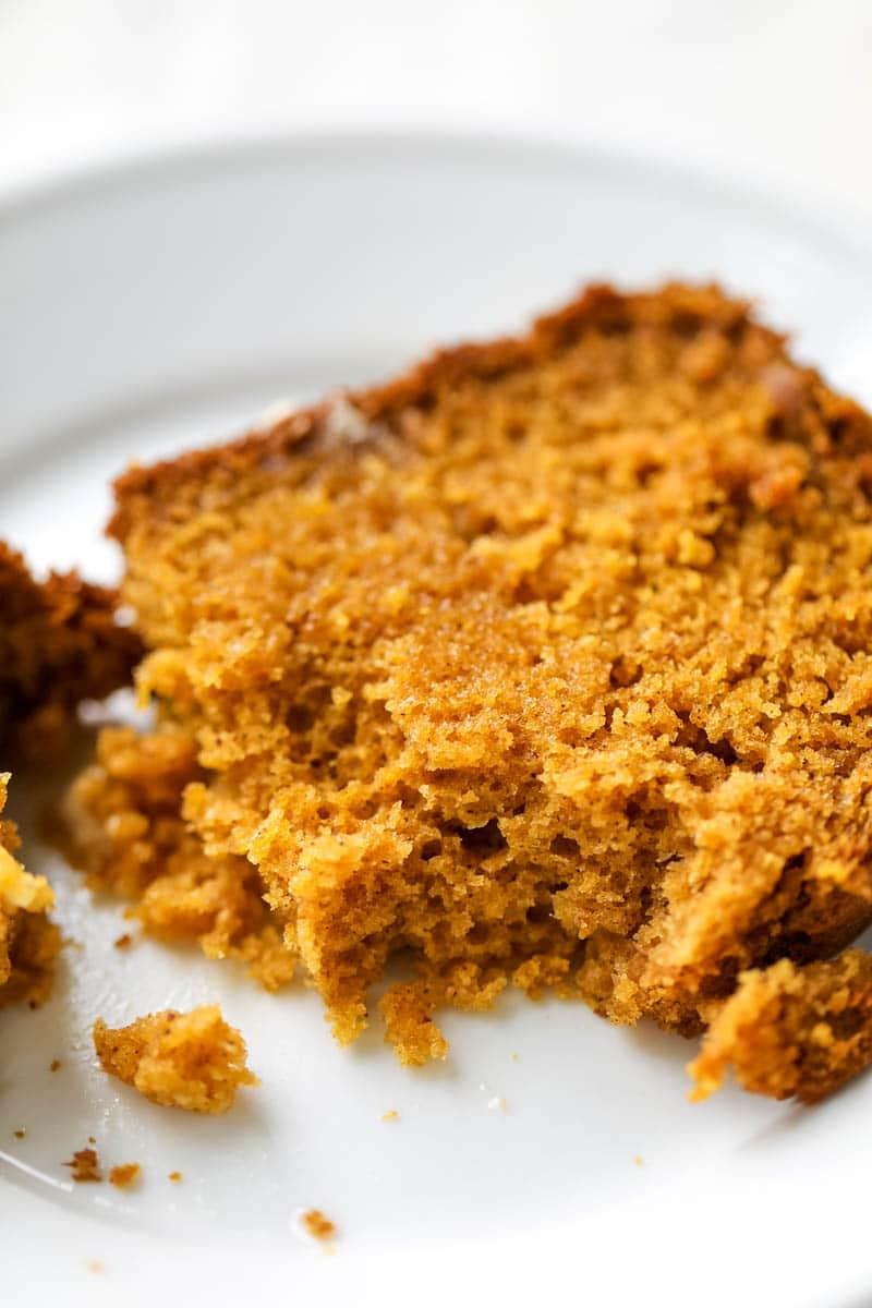 homemade pumpkin bread on a white plate