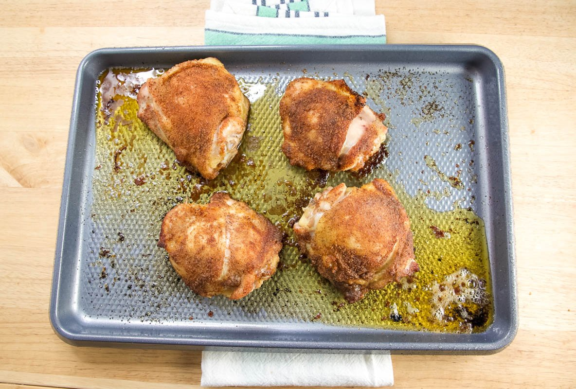 adding chicken to the baking pan
