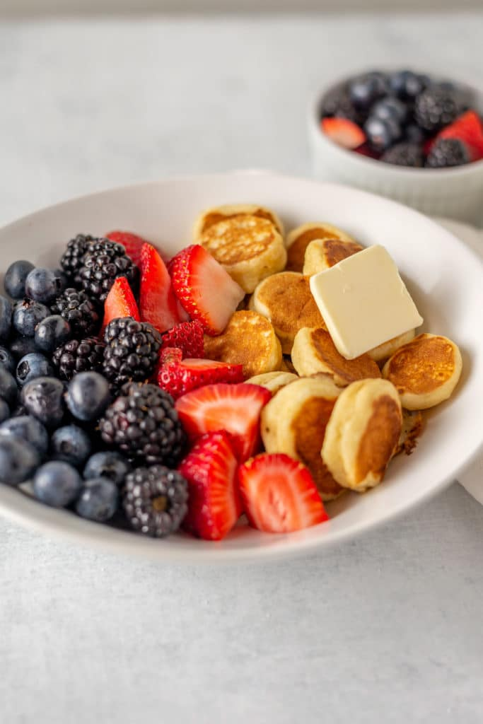 pancake cereal in a bowl with mixed berries