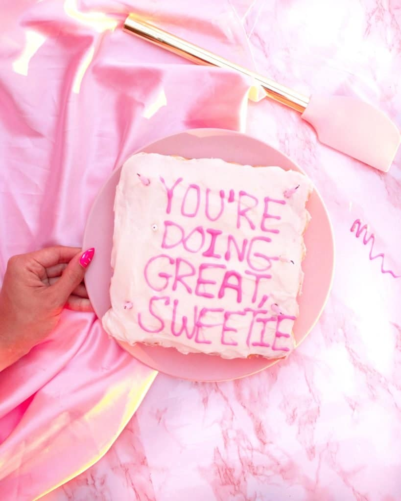 Picture of a piece of cake with text that reads you're doing great sweetie.