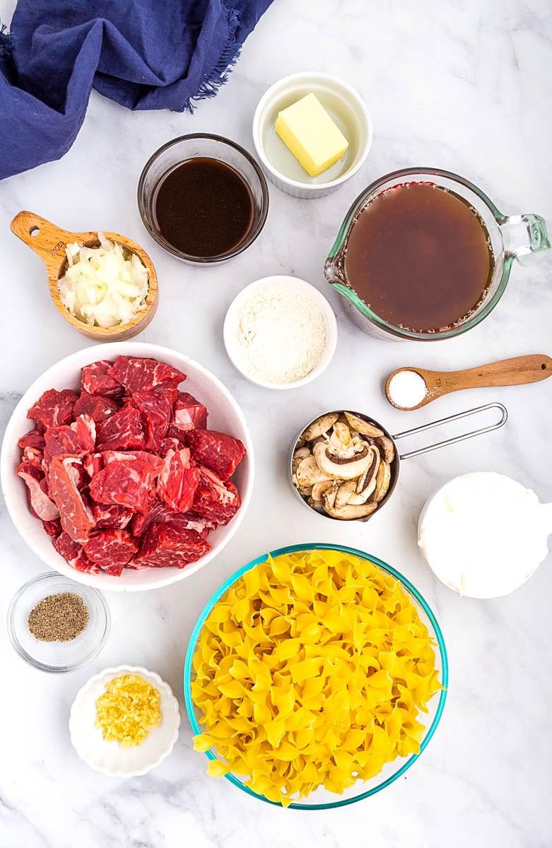 top shot of beef stroganoff ingredients in small bowls on countertop