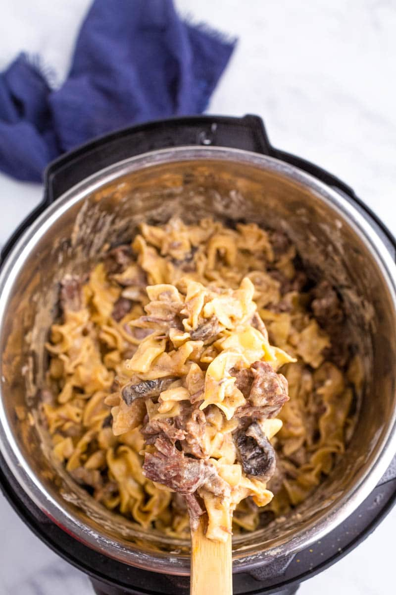 top shot of pasta and meat cooking in pressure cooker