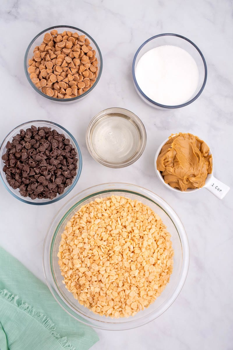 Ingredients for scotcheroos separated into small mixing bowls
