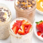 overnight oats with chia seeds in mason jar with spoon, topped with sliced strawberries