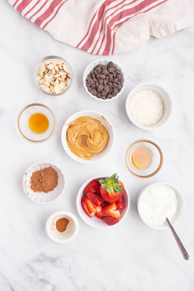 top shot of sweet and salting topping ingredients in small bowls on white countertop