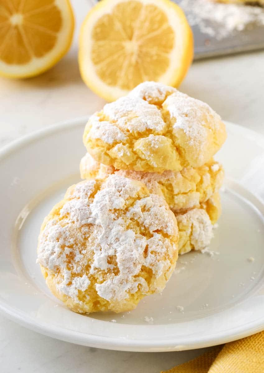 3 lemon crinkle cookies on a white plate