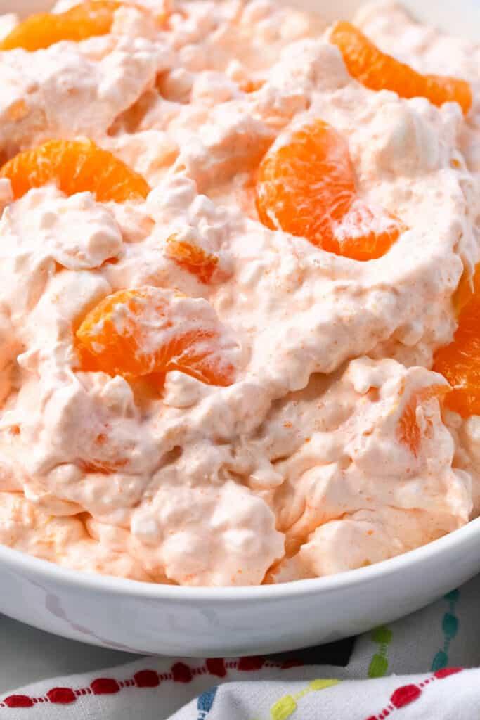 orange fluff in a white bowl