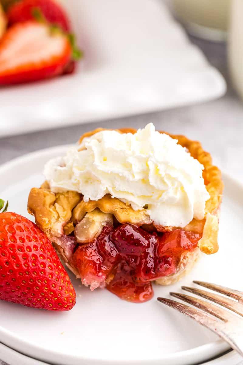 strawberry rhubarb pie on a white plate