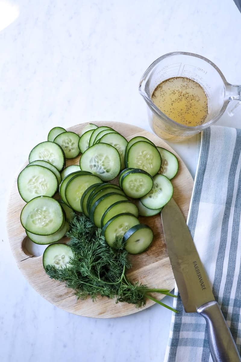ingredients for cucumber salad - cucumbers, dill, vinegar