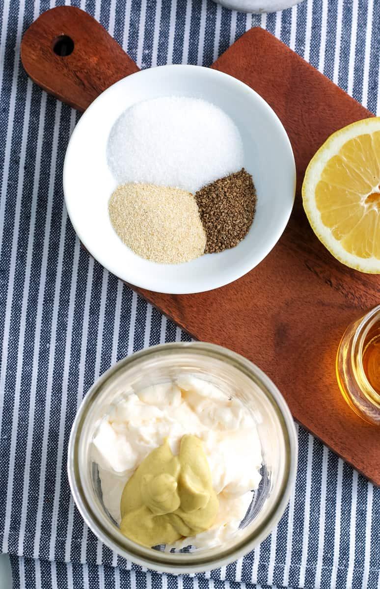 onion powder, celery seed, sugar, mayonnaise, mustard, lemon juice, cider vinegar