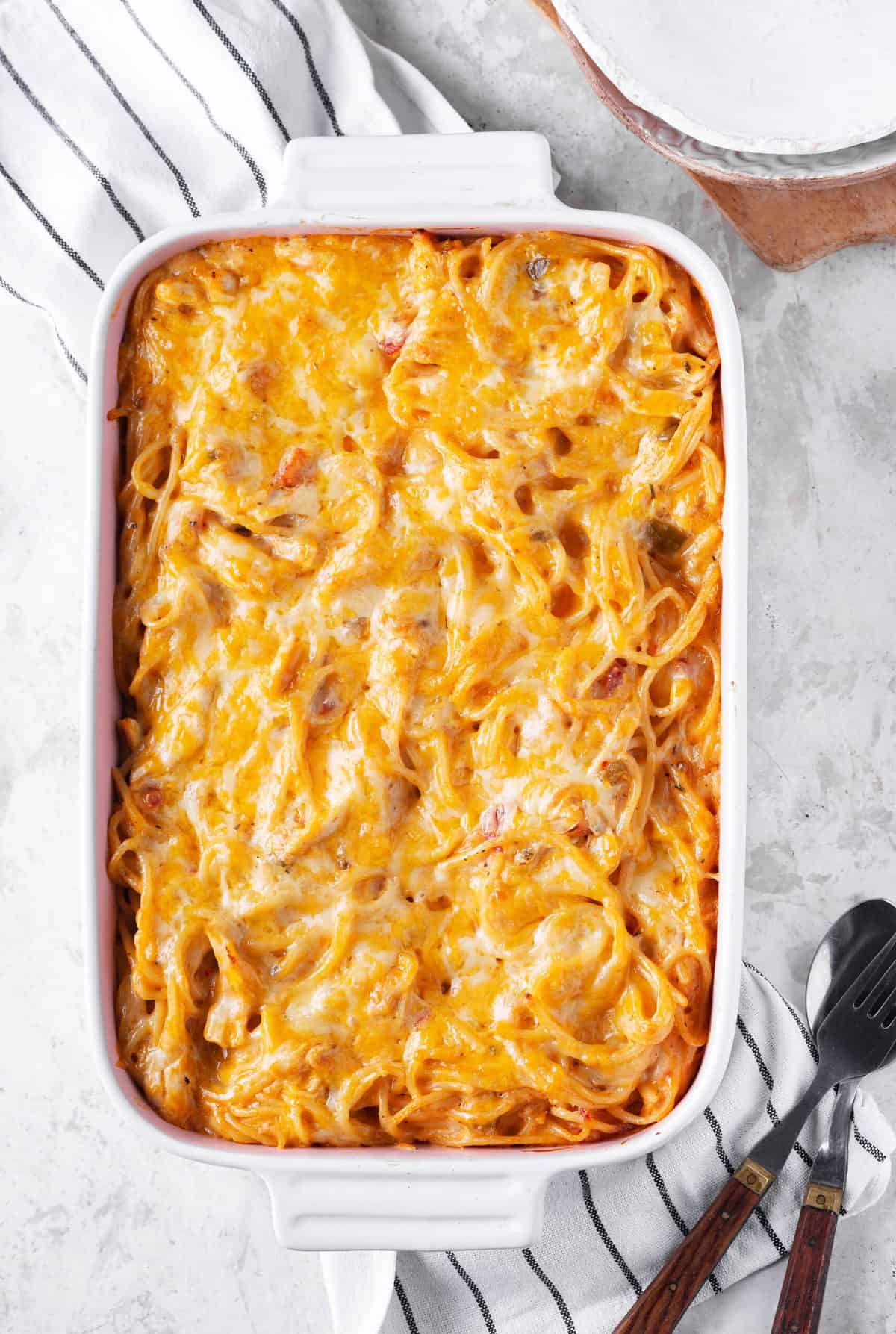 chicken spaghetti entree baked in a white casserole dish