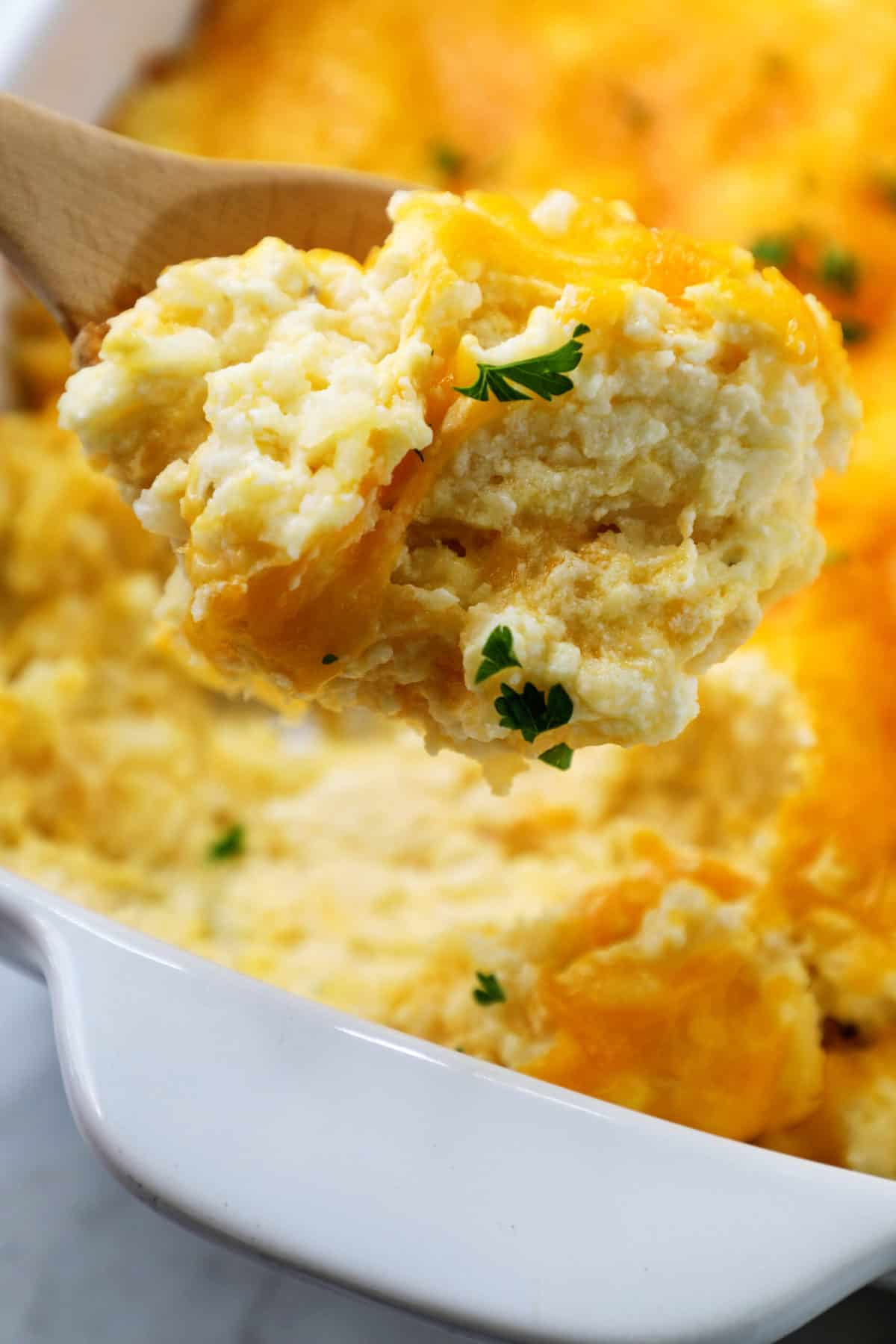 wooden spoonful of hashbrown casserole