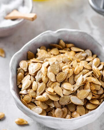 roasted pumpkin seeds served in a white bowl