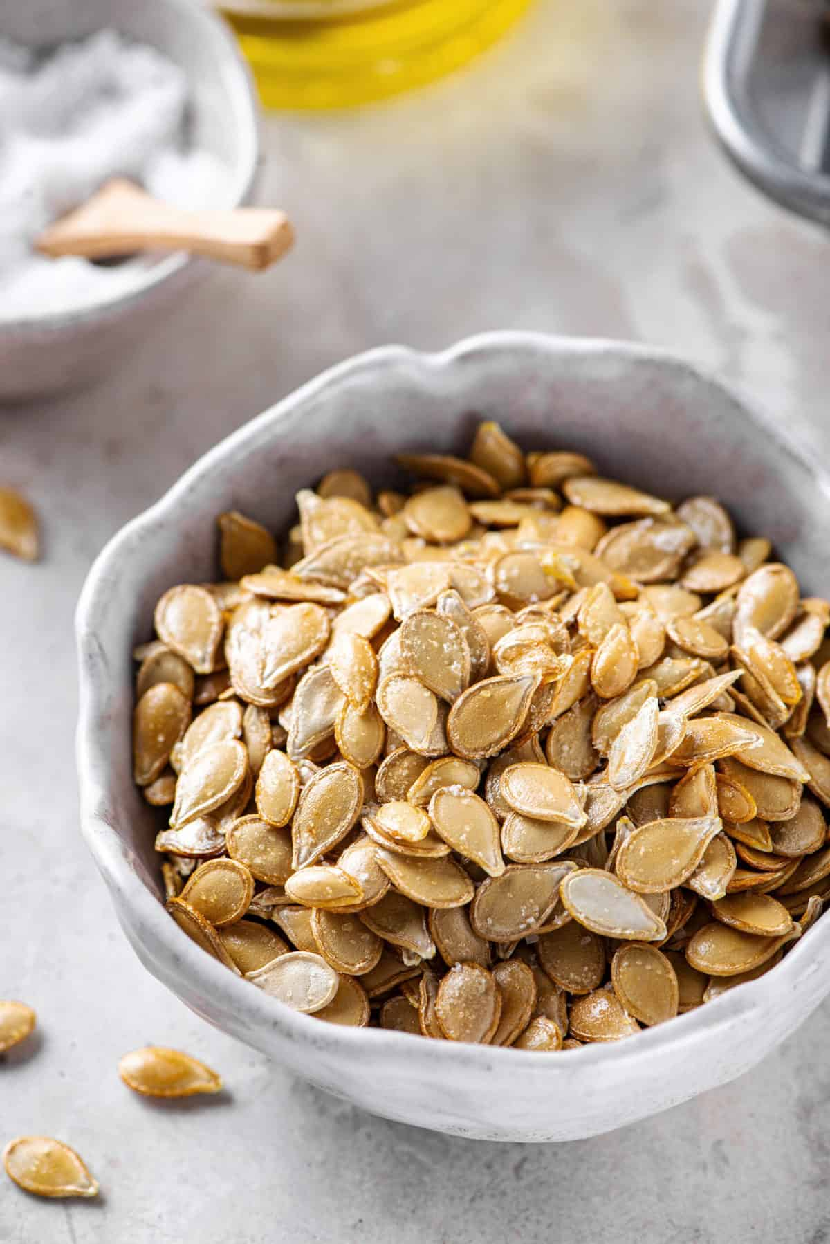 roasted pumpkin seeds served in a grey bowl